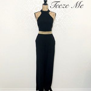 TEEZE ME BLACK AND GOLD HALTER JUMPSUIT SIZE 13/14